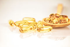 Yellow soft gelatin supplement fish oil capsule Stock Images