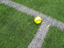 Yellow Softball. Softball and white corner marking on astroturf field Stock Images