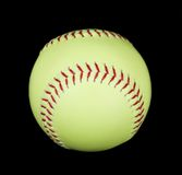 Yellow softball on black Royalty Free Stock Photos