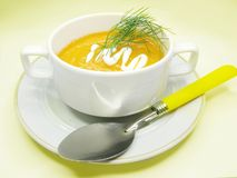 Yellow soup with carrot Stock Photography
