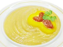 Yellow soup with pepper and tomato Stock Image