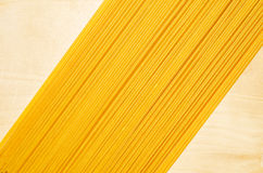 Yellow spaghetti. Yellow spaghetti close up on a light wooden background Stock Photography