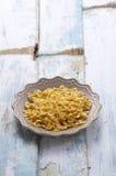 Yellow spaghetti in studio light Royalty Free Stock Photo