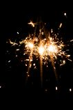 Yellow sparkler with fire particles Royalty Free Stock Images