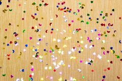 Free Yellow Sparkling And Glitter Background Witl Little Hearts, Stars And Moons. Top View. Royalty Free Stock Photography - 107684857