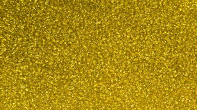 Yellow sparkling crystal background stock footage