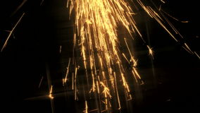 Yellow sparks shoot downwards Royalty Free Stock Images