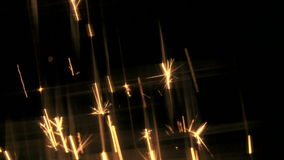 Yellow sparks shoot upwards Stock Photography