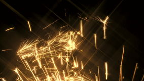 Yellow sparks shoot upwards Stock Photos