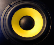 Yellow speaker. Yellow loud woofer speaker background Stock Images