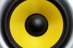 Yellow speaker loudspeaker close-up part of a musical column. A yellow loudspeaker close-up of a musical column, a symbol of music stock image