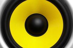 Yellow speaker loudspeaker close-up part of a musical column. A yellow loudspeaker close-up of a musical column, a symbol of music stock photo