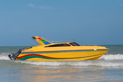 Yellow speedboat. Yellow speed boat on a clear sky and blue ocean background Royalty Free Stock Photography