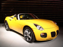Yellow speedster. Yellow convertible, sports car on display Stock Photos