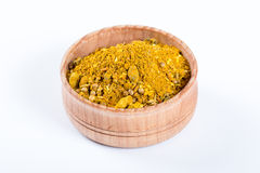 Yellow spices mix in a wooden bowl Stock Image