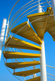 Yellow spiral ladder Stock Photography