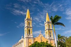 Yellow Spires and Azure Sky. Yellow spires of old town Mazatlan's cathedral sparkle against an azure blue sky Stock Images