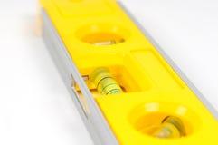 Yellow spirit level. Isolated on a white background Stock Image
