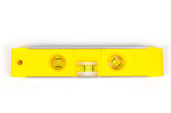 Yellow spirit level. Isolated on a white background Stock Photography