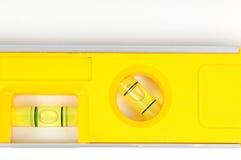 Yellow spirit level. Isolated on a white background Royalty Free Stock Image