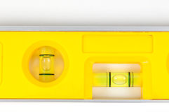Yellow spirit level. Isolated on a white background Stock Photo
