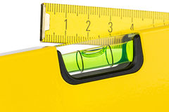 Yellow spirit level and folding rule Stock Photos