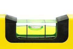 Yellow spirit level , macro image on white background. Yellow spirit level , macro image, on white background Royalty Free Stock Images