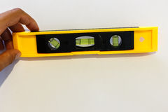 Yellow spirit level over white Stock Photo