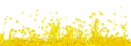 Yellow splash Stock Images