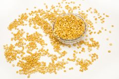 Yellow split peas with bowl royalty free stock photography