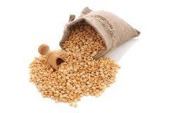 Yellow split peas in a burlap bag with an wood scoop Royalty Free Stock Images
