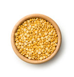 Yellow split peas in wooden bowl. Royalty Free Stock Images