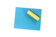Yellow sponge and blue cloth for cleaning. Isolated on white Royalty Free Stock Image