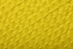 Yellow sponge foam as background texture Stock Images