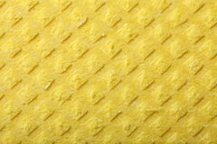 Yellow sponge foam as background texture Royalty Free Stock Images