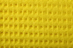Yellow sponge foam as background texture Stock Photography