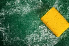 Yellow Sponge and Green Chalkboard Royalty Free Stock Image