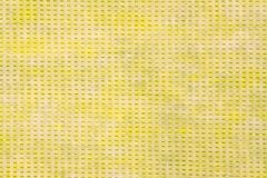 Yellow sponge texture with irregular color Royalty Free Stock Photo