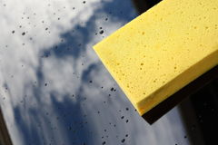 Yellow sponge used car wash Royalty Free Stock Photos