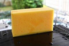Yellow sponge used car wash Stock Images