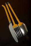 Yellow Spoon Knife and Fork. Dinner Knife, fork and spoon with a Yellow high light Stock Photography