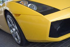 Yellow Sport Car Wheel. Detail of car Stock Photos