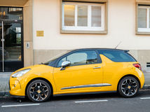 Yellow sport Citroen Car parked in city Royalty Free Stock Images