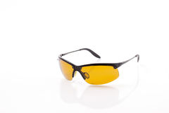 Yellow sport polarized sunglasses Royalty Free Stock Images