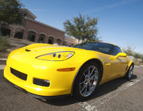 Yellow sports car. Parked in shopping mall area Royalty Free Stock Photos