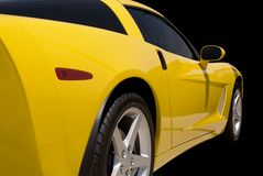 Yellow Sports Car. Isolated on a black background. Clipping path included. Several more of this car in my gallery to pick from Royalty Free Stock Photography