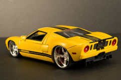 Yellow sports car. Picture of a toy car. Focus is centered around the tail light area Stock Image