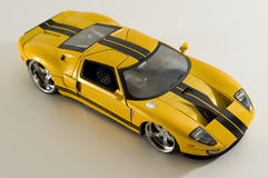 Yellow sports car. Picture of a miniature replica of a toy car Royalty Free Stock Photo