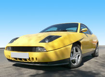 Yellow Sports Car. A bright yellow sports car against a clear blue sky Stock Photos