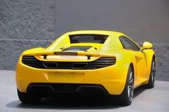 A yellow sports car on display. A photo taken on the back of a yellow sports car on display Royalty Free Stock Photos